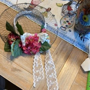 Wire, floral and ribbon hat form